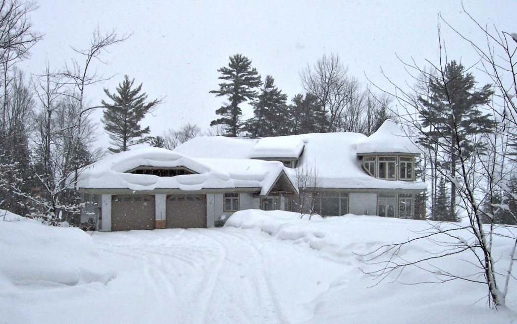 Our Parry Sound destination--Mom and Dad's house under a deep blanket of snow, with clouds above promising still more.