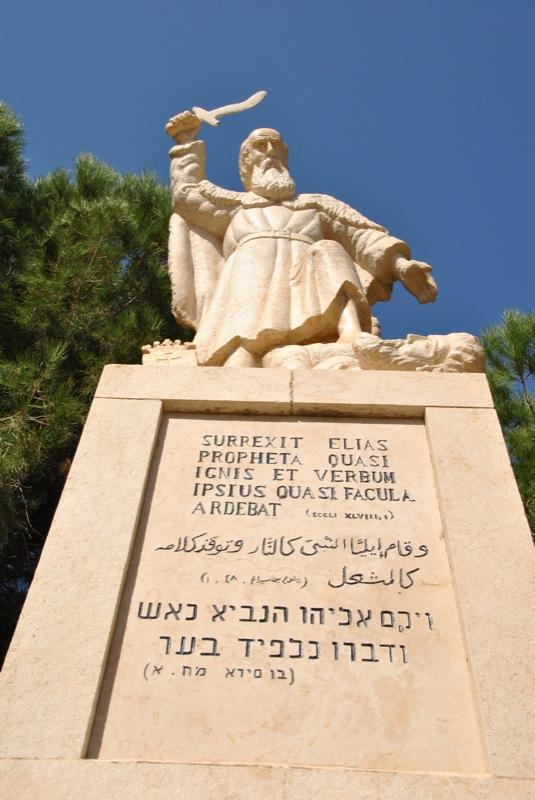 Elijah, wielding sword and satire for God.