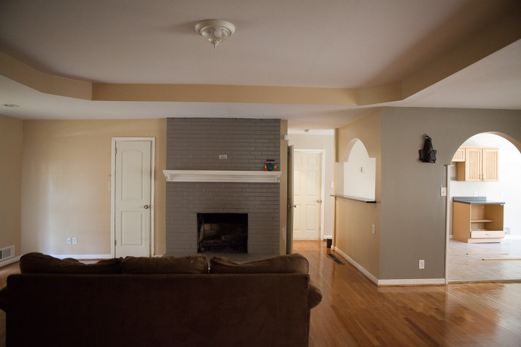 """The main hosting area. L to R: living room, kitchen, dining room. The door in the center leads into the """"piano teaching room,"""" a bathroom, and a laundry."""